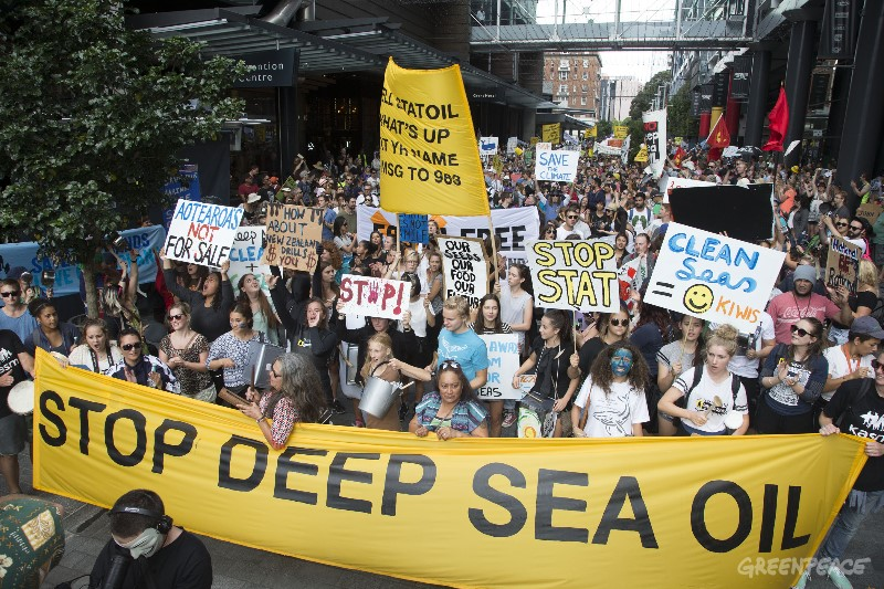 Thousands of protesters march against deep sea oil drilling in Auckland today. Carrying placards and beating drums they show their opposition to the government's oil drilling programme saying it poses risks to New Zealand's marine mammals, oceans, coasts, economy and way of life. The march started at Victoria Park with speeches and live music and ended outside Skycity Convention Centre where the Advantage New Zealand Petroleum Summit is taking place. Energy and Resources minister Simon Bridges is expected to announce the 2015 Block Offers during the conference, which will determine how much more of New Zealand's ocean territory is opened up to foreign drilling ships intent on finding deep sea oil. The march was organised by Greenpeace, 350 Aotearoa, Kiwis Against Seabed Mining and Oil Free Auckland
