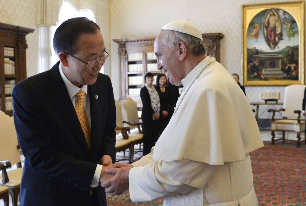 U.N. Secretary-General Ban Ki-moon shakes hands with Pope Francis during a meeting at the Vatican