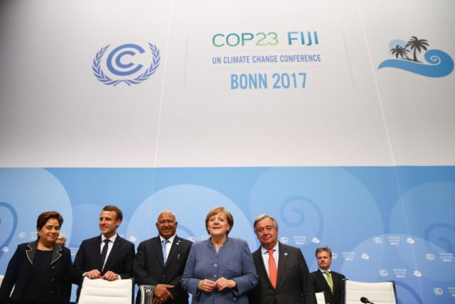 Patricia Espinosa, Executive Secretary of the United Nations Framework Convention on Climate Change, French President Emmanuel Macron, COP23 President Prime Minister Frank Bainimarama of Fiji, German Chancellor Angela Merkel and U.N. Secretary-General Antonio Guterres pose for a photo during the COP23 U.N. Climate Change Conference in Bonn, Germany, November 15, 2017. REUTERS/Wolfgang Rattay