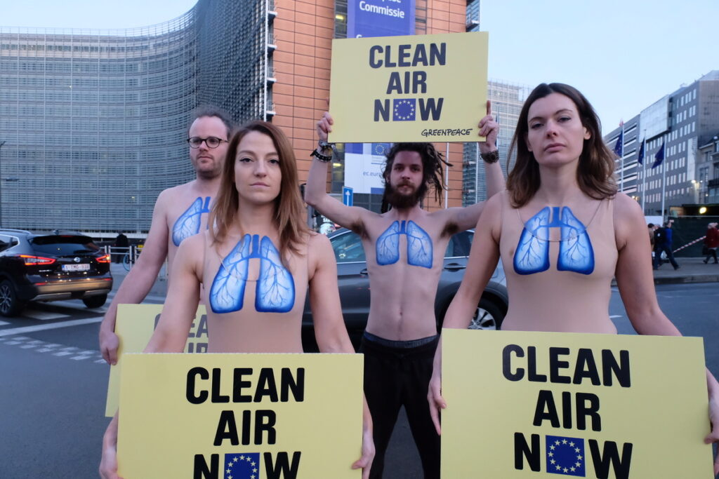Greenpeace activists, with body-painted lungs on their chest, protest in front of the EU Commission Building against the lack of credible action against harmful air pollution in European countries.