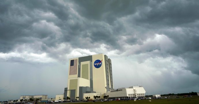 Storm clouds pass over the Vehicle Assembly Building as the SpaceX Falcon 9, with the Crew Dragon spacecraft on top of the rocket, sits on Launch Pad 39-A Wednesday, May 27, 2020, at Kennedy Space Center in Cape Canaveral, Fla. Two astronauts will fly on the SpaceX Demo-2 mission to the International Space Station scheduled for launch Wednesday, weather permitting. (AP Photo/David J. Phillip)
